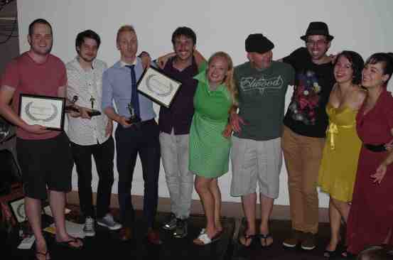 "L-R: Nic Barker (Best Comedy, Pint), Marty Gubbins (Best Cinematography, Pint), Stefan Bugryn (Dir. Best Drama, A Fairy Tale) , Julian Zuliani (Producer. Best Drama, A Fairy Tale), Lindsey Loon (CFF founder), Tom Vogel (Dir. Mabowezi), Ivan Malekin (Dir. Reckoning), Sarah Jayne (Dir. Dusk), Hana Vraniqi (Actor, Red Aces ""Death Comes for All"" and Simple Happiness)"